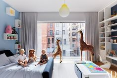 Tristan, the couple's son, is joined in his room by his sister, Emma, and their dog, Cookie; the bed is by De La Espada, and the drawing table is by Ducduc.