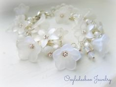 This charming garden bracelet is made with lucite flower beads, crystals, and freshwater pearls. Each bead is wire wrapped by hand to a sterling silver