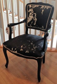 This stunning black and white reproduction French Chair has been painted in a durable gloss black enamel, upholstered with Salt & Pepper