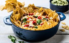 The meat has been replaced by beans and root veggies in this flavour-packed nachos recipe. Topped with lovely cheese, creamy guacamole and a twist of lime, the nachos are great for any festive occasion - quick and easy to make in large quantities. Guacamole, Taco Spice Mix, Nacho Chips, Root Veggies, Chicken Nachos, Sandwiches, Winter Food, Us Foods, Cheddar