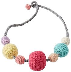 Fun handcrafted crochetwork in a showstopping cotton necklace to finish the look.   <br>•100% cotton yarns  <br>•Easy loop closure  <br>•Ages 3 and up <br>•Imported  <br><br>WARNING: CHOKING HAZARD – Small parts. Not for children under 3 years of age.
