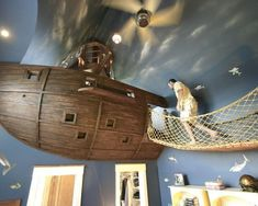 This fantastical house boasts fun surprises for kids and adults alike: a floating pirate ship bedroom, a hidden slide to the basement, a climbing wall, and video golf room. #coolbeds