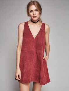 Retro Love Suede Dress   In a luxe suede, this sleeveless mini dress features a plunging V-neckline with hip pockets. Exposed zip closure in back.
