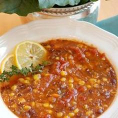 Black Bean Vegetable Soup ~ Ingredients  1 tablespoon vegetable oil  1 onion, chopped  1 clove garlic, minced  2 carrots, chopped  2 teaspoons chili powder  1 teaspoon ground cumin  4 cups vegetable stock  2 (15 ounce) cans black beans, rinsed and drained  1 (8.75 ounce) can whole kernel corn  1/4 teaspoon ground black pepper  1 (14.5 ounce) can stewed tomatoes