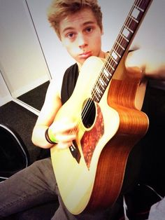 Lucas sang me a song today. It was called 'penguins'. Randomest song in the world. But at the end he said 'I love you'. Now I have it on a DVD and play it about everywhere I go xD (only pic I could find of Luke playing guitar. )