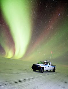 Keepers of the Ice, by Dave Brosha- Pictured is a Nuna Logistics truck, which is the company that builds and maintains the ice road between Yellowknife and Northwest Territories' three diamond mines.
