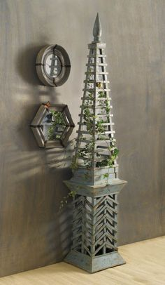 "Pair of obelisk form topiaries in green lattice stained fir wood.  (87"" T X 15.75"" square base)"