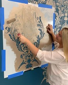 DIY painted and stenciled metallic damask accent wall makeover ideas on a budget using easy to use wall stencil patterns from Cutting Edge Stencils