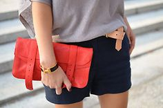 Blue Shorts, flowy top, with a pop of color.