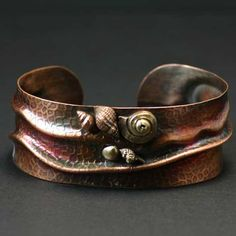 Cuff | Heidi Egerman.  copper with patina and bronze and copper PMC shells.