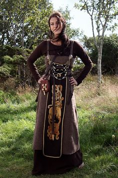 Amazing embroidery, and unusual small apron on top of the 'standart' apron dress. http://www.valkyrja.com/
