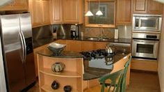 Image result for wood color cabinets and dark quartz countertops