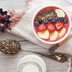 Strawberries, cherries, coconut (shredded), blueberries, almond milk, pumpkin seeds, hemp seeds, banana and chia seeds smoothie