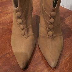 Nicole Miller Booties Adorable suede tan Nicole Miller booties. Pointy toe snd cute button detail down the front. Never been worn but there are some imperfections in the suede. All sales are final. Price is flexible - make me an offer! Nicole Miller Shoes Ankle Boots & Booties