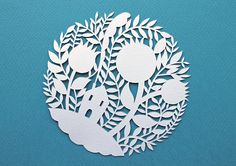 Little house in a forest by Silvia Raga. (Paint a thin shadow to emulate the paper-cut look?)