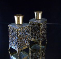 Vintage Footed Perfume Bottles Metal Filigree Fragrance Oil Containers Bathroom Vanity Decor  Glass bottles encased with metal filigree App. 5 tall x 2 wide these stylish bottles have an undeniable charm Fill them up with your favorite bath oils or use them as a decorative accent on your vanity counter Great condition with no chips or cracks
