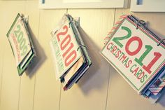 Oh Louise!: DIY Christmas Card Books - I've been looking for a crafty way to keep and store all my bday cards.. This gives me a great starter idea!
