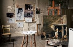 Andrew Wyeth: a reproduction of Raccoon (1958) on the easel and reproduction drawings taped to the wall of the studio.