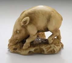 Japan  Wild Boar Rooting, 19th century  Netsuke, Ivory with staining, sumi. LACMA