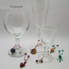 This is a set of six wine glass charms that will help you distinguish your glass from other guests. Each charm is unique and will include my handmade