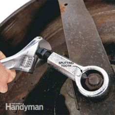 Loosen a stuck nut by breaking it with a nut splitter.
