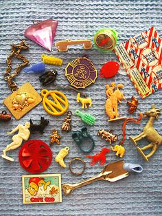 Vintage Cracker Jack and gumball machine prizes.