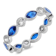 Please Take A Moment To Visit Our Store!        Item Number: RC106338  Availability: Usually Ships in 5 Business Days      PRODUCT DESCRIPTION:    Crafted in sterling silver, this beautiful band features Sapphire Blue Marquise Shape CZ stones that alternate with brilliant machine-cut cubic zirconia stones and is accented by a milgrain finish.        FEATURES:      Crafted in Fine Sterling Silver  Rhodium Plated  Sapphire Blue Marquise Cubic Zirconia  Brilliant Machine-Cut Cubic…