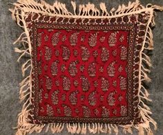 Decorative pillow cover, block printed with red traditional print at the front natural cotton and plain Irish linen fabric on the backside with the zipper attached at the back in envelope style.  DETAILS:  * Hand block printed * Rich organic natural dyes * Traditional methods * Tassel detail * you