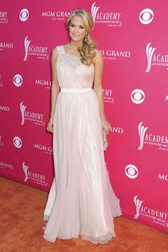 A married woman with pride, Carrie Underwood, left her revealing clothes backstage for a while as she entertained with a black tuxedo and showed her wedding ring at the CMA Awards. Description from usspost.com. I searched for this on bing.com/images