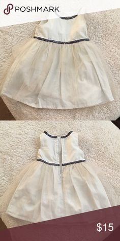 Dress Off white with gold sparkle. Has navy blue ribbon around neck and waist. Worn once for pictures. Excellent condition Carter's Dresses Formal
