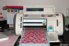 """I am a fairly """"new"""" owner of a cricut. I've had mine for less than a year and have already done so much with it! From cutting paper to vinyl, and now fabric! I'll walk you through some steps on how to cut fabric with your cricut using an iron-on"""