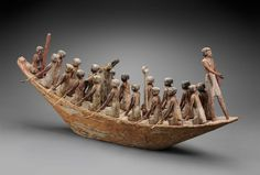 Model of an ancient Egyptian funerary transport boat model, circa 2010–1961 B.C.  The tomb of Djehutynakht contained what may be the largest collection of wooden models ever discovered in Egypt.  Although they vary in size and quality, all of Djehutynakht's boat models are constructed in the same fashion, with the hull carved from a single piece of wood, while the cabins, masts, other fittings, and crews were made separately and attached with pegs.