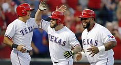 Texas Rangers right fielder Shin-Soo Choo (left) and designated hitter Prince Fielder (right) celebrate left fielder Mike Napoli's three-run homer during a big first inning against the Houston Astros Wednesday, September 16, 2015 at Globe Life Ballpark in Arlington, Texas. (G.J. McCarthy/The Dallas Morning News)