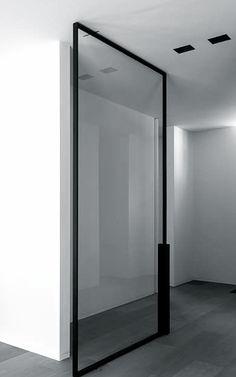 | DETAILS + DOORS | full height glass pivot doors w/ black frame detailing