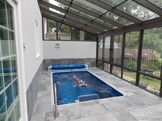 Pool enclosures make an affordable option for year-round swimming in a sunroom environment. When the light is right, the overhead panels will make a clever backstroke mirror for this swimmer! This Original Endless Pool, located in Rochester, New York, fea Swimming Pool Enclosures, Fiberglass Swimming Pools, Swimming Pools Backyard, Swimming Pool Designs, Lap Pools, Pool Landscaping, Lap Swimming, Patio Enclosures, Pool Decks