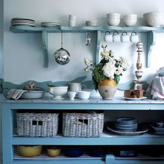 love the simple open shelves and baskets. nice color too