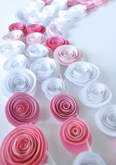 Beautiful Paper Flower Garland by lillesyster via Etsy  - A ligth chain with paper flowers would be nice!