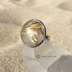 Large round Golden Rutilated Quartz ring with gorgeous clarity set in 925 sterling silver. The gold rutile in this ring, magnified by quartz, helps add laser focused power boosting for manifesting abundance.  www.crystalrockstar.etsy.com