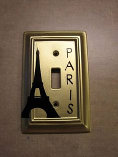 My tween converted her little girl room to a Paris theme, so I spray painted the pink switch plates gold and added black vinyl with my Cricut.