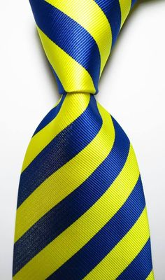 6f4edf1920d9 A perfect classic 100% silk jacquard navy and yellow striped tie for all  occasions at
