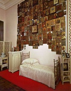 The bedroom of Empress Alexandra, wife to Nikolay II in The Alexander Palace of Tsarskoye Selo. How many icons are on the wall...