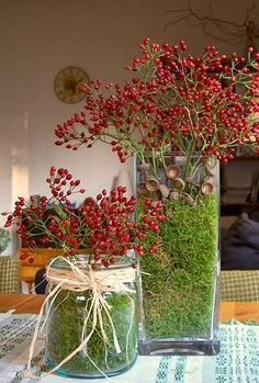 Glass vases red berries