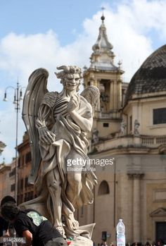 Sculpture Angels | News Photo: statue half angel half demon is used on…