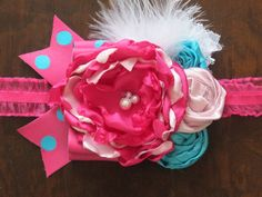 This is one of my over the top, photo prop or party type headbands. Polka dot ribbon bow, pink and aqua satin, white lace and feather. Comes in sizes newborn 0-6, 6-12, 12-18, 18-24, 24+. Please leave the size you want in the notes box when checking out. All orders ship within 3-5 days.