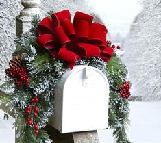 """Snow Flocked Mailbox Swag with Red Velvet Ribbon CR4840 - Decorated your mailbox with our lovely snow flocked mailbox swag. Created with mixed oine, red berries, faux snow and pine cones. Accented with a hand crafted red velvet wired bow. Measures 36"""" L x 12"""" W Easily attaches with an included wire!"""