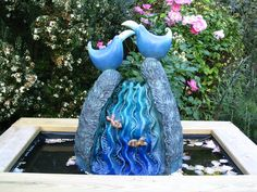 If you're looking for something colorful and whimsical, this 'Blue Birds With Rose Petals' garden sculpture might be just what you're looking for.  It looks best with a water feature, so if you'd like to add a koi or reflecting #pond with a sculpture to your Minneapolis MN yard, contact us at http://www.aldmn.com