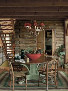 Cabin Fever  The owners of this cozy Vermont cottage paired a rare 1930s rectangular rag rug with an antique French-Canadian dining table and an array of chairs dating from the 1880s. The home's original exterior walls are visible in the background.