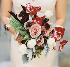 wild bouquet of sterling roses, lambs ear, black calla lilies and orchids by Krista Jon