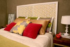 DIY headboard made from spray painted rubber doormats! I have to say, that's genius!