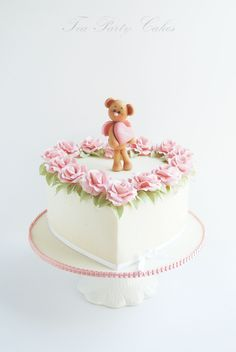 Sweet Teddy Valentine - Heart shaped cake I made for a friend's little sweetheart who was turning 5. The little fondant teddy cupid and gum paste rose border makes this a great cake for Valentine's Day as well. TFL! :)